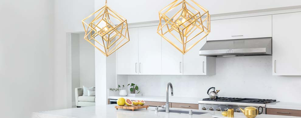 A Kitchen with Gold Pendant Lights
